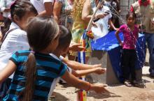 Children playing with water in Honduras
