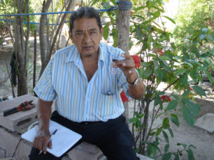 Chair of Water Committee in El Salvador checking water quality